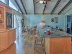 You'll have additional bar seating on the kitchen island to utilize.