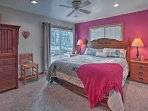 You'll have direct access to the great outdoors from the master bedroom's sliding glass door out to the deck.