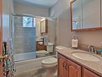 The second bathroom features a single vanity and shower/tub combo.