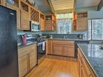 The kitchen is fully equipped with updated appliances and granite countertops.