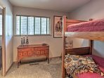 Send the kids to sleep tight on the twin-over-twin bunk bed in the second bedroom.