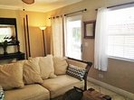 1 br 2 bath upstairs section with french door leading out to tropical wrap around balcony w/ flowers