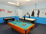 Actioned packed games room with pool table, air hockey and foosball
