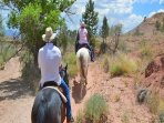 Take a horseback ride trip through Ghost Ranch.