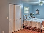The second bedroom provides ample closet space and a queen mattress.