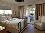 Queen bed with French doors to private courtyard