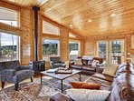 Living room with Luxury furniture, fireside seating, views through every window.