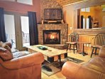 Main level Living Room is Cozy, and is ideal for gathering and entertaining