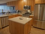 A large island in a kitchen with great flow