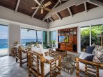 Living room featuring large sliding glass doors to let that Kona