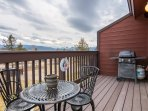 Private deck off of living area with gas grill