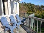 Decks overlooking gardens and view of ocean