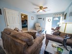 Relax inside or just out the front door on the porch while the kids play in the spacious yard!