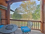 Step out onto the master suite balcony to find cushioned seating and a table fire pit.