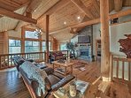 This impressive 3,200-square-foot log cabin boasts fabulous amenities and ample accommodations for 12 guests to enjoy.