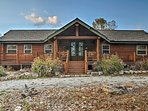 Get away to Table Rock Lake when you stay at this gorgeous 4-bedroom, 2.5-bathroom Shell Knob vacation rental cabin.