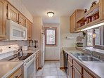 Kitchen - The kitchen is fully stocked, there is even a tea kettle for your use. SkyRun also provides complimentary...