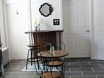 breakfast bar with swivel bar stools, cafe table, chairs
