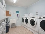 Coined laundry machines are available within the complex.