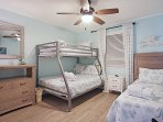 This bedroom features a twin-over-full bunk bed and a full-sized bed.