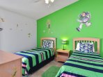 TOY STORY & TINKER BELL themed twin beds with a shared full bath