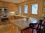 Kitchen has seating for 3 and Gore Creek views