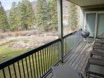 Deck looks out over the Gore creek and has a BBQ grill