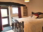 Double bedroom with exit onto lane by riverside
