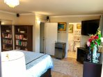 Suite Bedroom 1 with fridge, Microwave, coffee maker, Roku Large HDTV