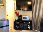 HDTV, Microwave, coffee maker, 1/2 fridge w Freezer