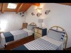 Bedroom upstairs  2 single beds