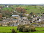 Hinchliffe Mill in the valley bottom taken from Cartworth Moor