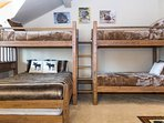 Bunk room with twin over twin bunk, twin over full bunk and one additional twin trundle