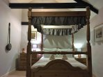 Four poster bed and vaulted ceiling in the upstairs double (also has large en suite)