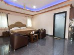 Spacious apartment with beautifully lit bedroom, couches, balcony, AC, washing machine