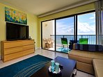 Living room has a wonderful water view and access to the balcony.