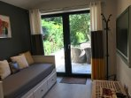 Garden View Living Room with Sofa Bed, once pulled out becomes a double bed, sleeps 2 adults