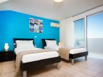 Bedroom 3, twin beds & sea view balcony