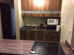 Modern kitchen with induction hob, fan oven and microwave