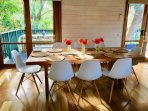 Dining area overlooking massive garden & splendid banksia tree growing through the deck