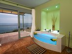 Relax with the view of the Ionian Sea by arranging chromatotherapy in the hydromassage
