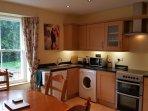 Large fully equipped kitchen including dishwasher, washer/dryer, full size fridge/freezer.