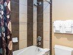 Upper level common bathroom shower