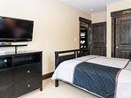 Flat screen TV in third bedroom