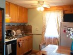 Kitchen / dining area table, 2 chairs, fridge, microwave