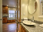 Wash up in the bathroom, equipped with a single vanity and walk-in shower.