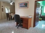 Light, spacious, and airy Work Station with office table with drawers and swivel chair and books