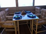 Enjoy a meal on the enclosed balcony as you watch dolphins playing
