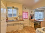 The fully equipped kitchen offers brand new appliances, including a microwave, refrigerator, and dishwasher.