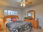 The master bedroom houses a plush queen bed for 2 lucky guests.